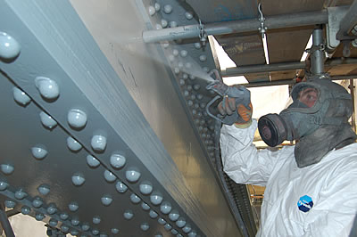 Close-up of the white paint being applied to the North East Land Tie