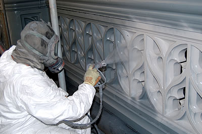 White paint being applied to the Bridge Parapet