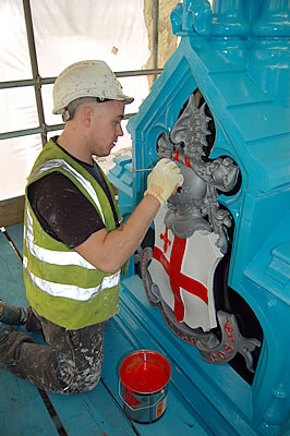 Painting the shield below the lamp stand on the North East Bridge Balustrade
