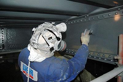Contractors applying High Build Aluminium paint to the underside of Tower Bridge