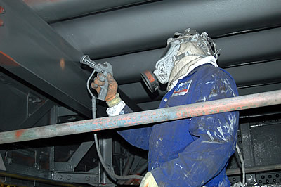 Contractors applying a coat of High Build Aluminium paint to the underside of Tower Bridge