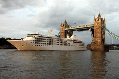 Silver Cloud passes through the raised Tower Bridge