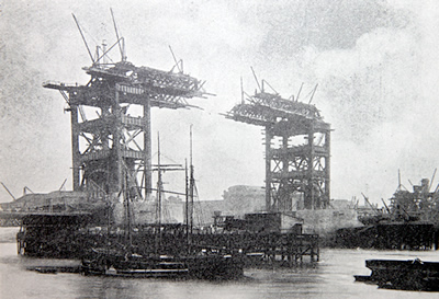 This image taken during the construction of Tower Bridge shows the cantilevers a short time before they met
