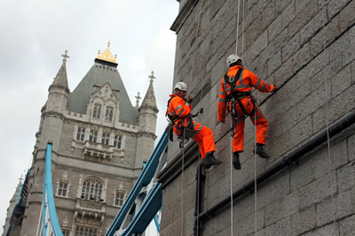 Abseilers inspecting the stonework and pointing