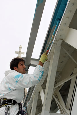 Abseiler applying the Finish Coat on the West Walkway